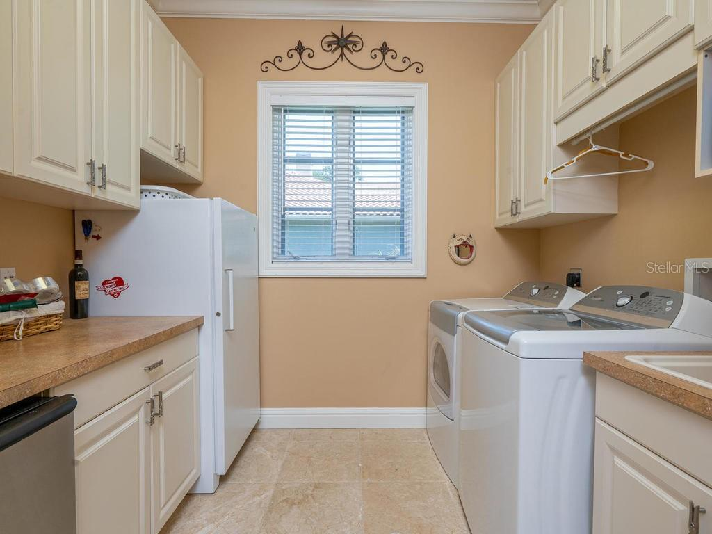 Laundry room and butlers pantry - Single Family Home for sale at 158 Puesta Del Sol, Osprey, FL 34229 - MLS Number is A4439362