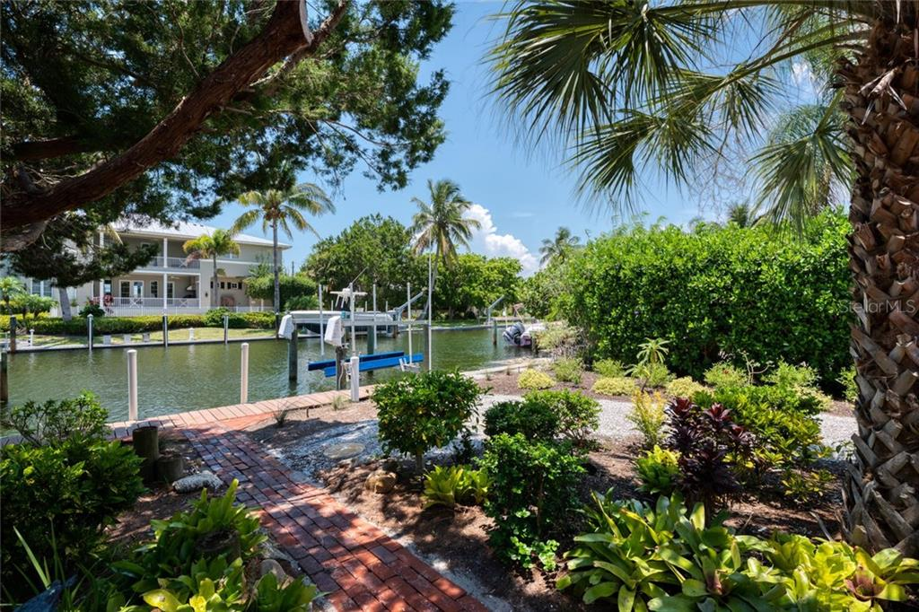 A relaxing back yard with a view, and a fisherman's shack for your toys - Single Family Home for sale at 701 Norton St, Longboat Key, FL 34228 - MLS Number is A4440596