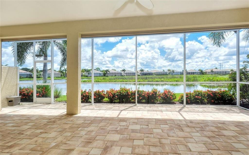 Spacious Paver Brick Lanai with wide open Lakeview - Single Family Home for sale at 1696 Lancashire Dr, Venice, FL 34293 - MLS Number is A4441325
