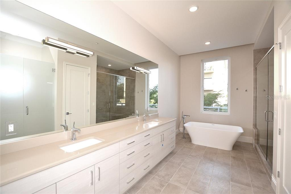 Luxurious master en-suite with plenty of storage. - Condo for sale at 609 Golden Gate Pt #202, Sarasota, FL 34236 - MLS Number is A4441802
