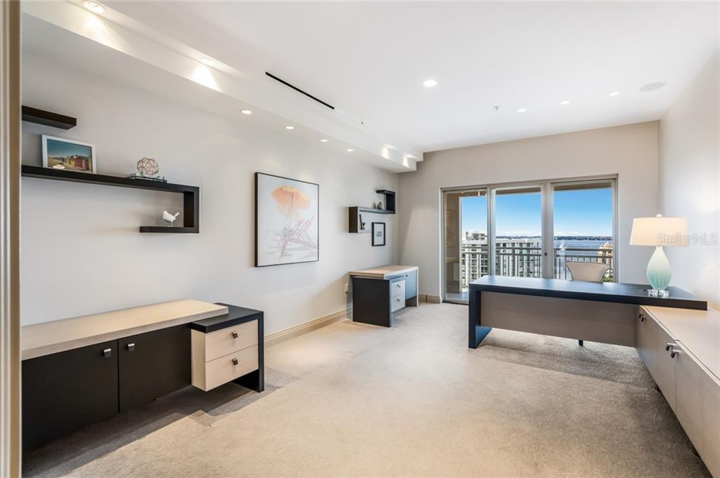 The generously sized office overlooks the bay and also features a balcony. - Condo for sale at 1111 Ritz Carlton Dr #1704, Sarasota, FL 34236 - MLS Number is A4442192