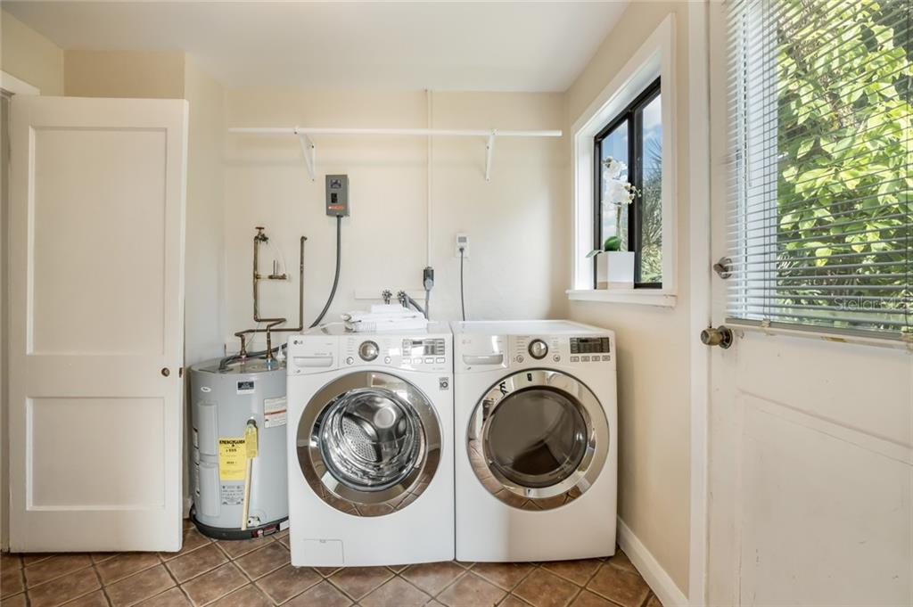 Laundry room with new washer and dryer. - Single Family Home for sale at 1763 6th St, Sarasota, FL 34236 - MLS Number is A4442510