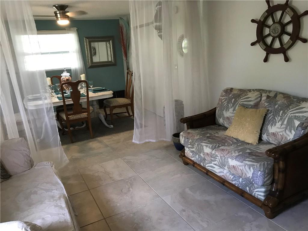 Casual den and formal dining area - Duplex/Triplex for sale at 4418-4420 100th St W, Bradenton, FL 34210 - MLS Number is A4443821