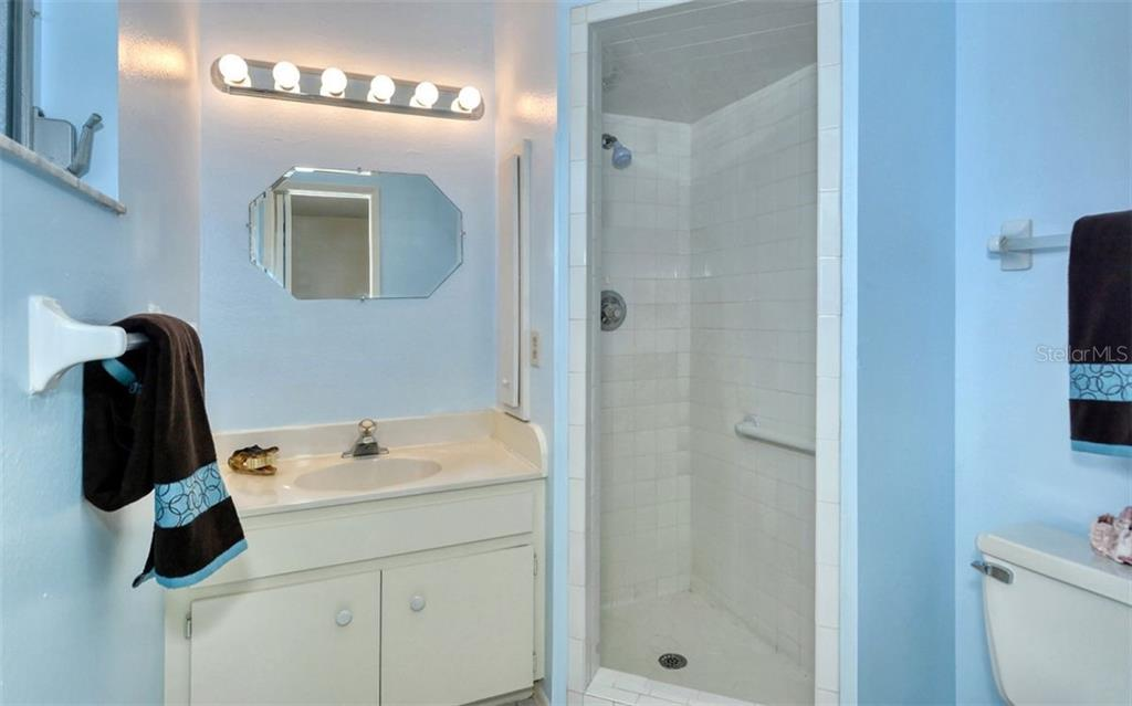 The master bath features a walk in shower - Single Family Home for sale at 3286 Jamestown St, Port Charlotte, FL 33952 - MLS Number is A4444310