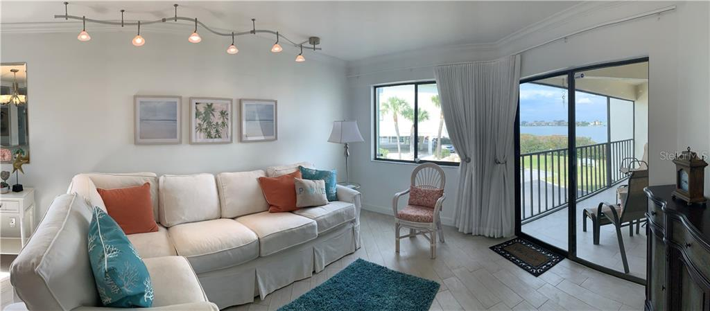 Double doors lead into the master bath, which was completely remodeled only 4 years ago as well. - Condo for sale at 501 Gulf Dr N #305, Bradenton Beach, FL 34217 - MLS Number is A4445601