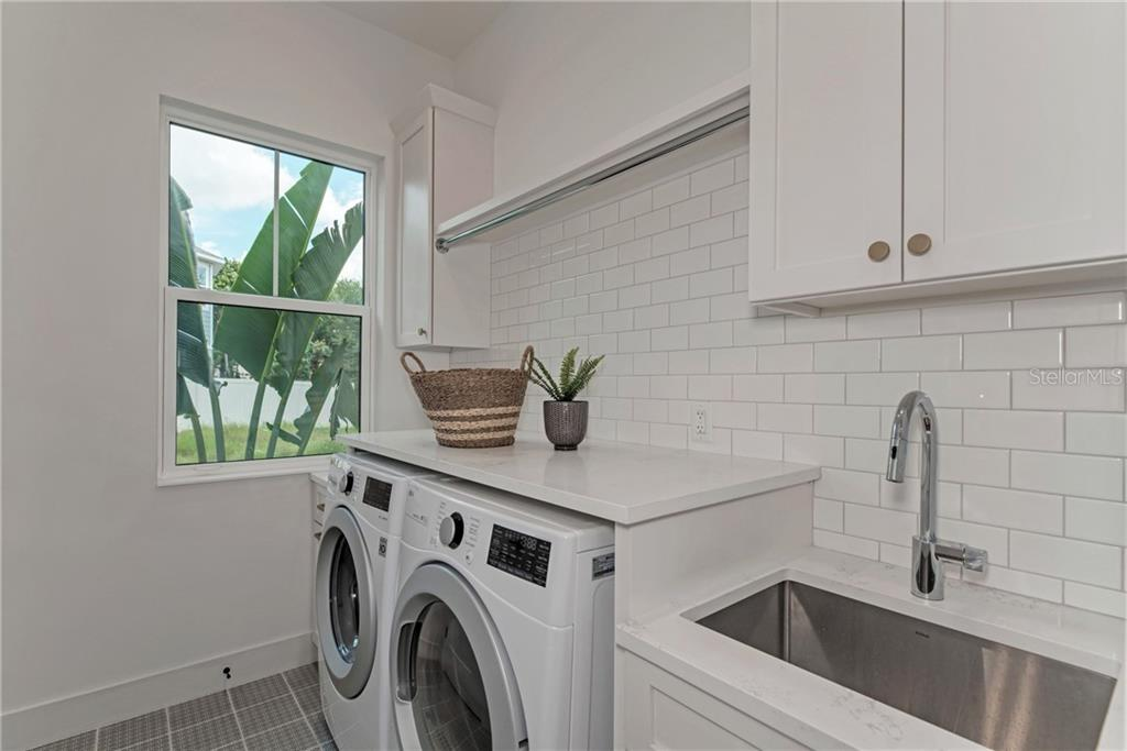 1st Floor Laundry Room - Single Family Home for sale at 5035 Sandy Beach Ave, Sarasota, FL 34242 - MLS Number is A4445640