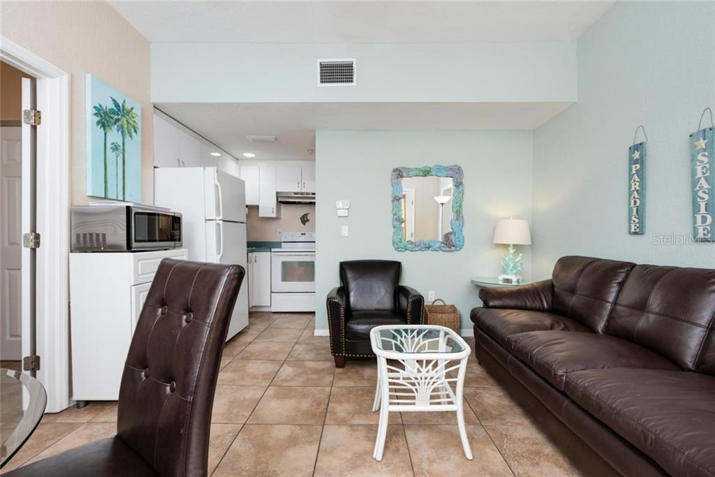 Ringmaster Living and Kitchen and Dining. - Single Family Home for sale at 523 Beach Rd, Sarasota, FL 34242 - MLS Number is A4446354