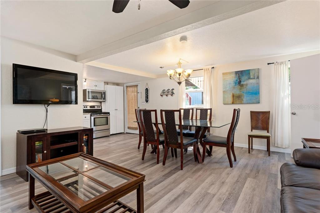 Elephant Living and Dining. - Single Family Home for sale at 523 Beach Rd, Sarasota, FL 34242 - MLS Number is A4446354