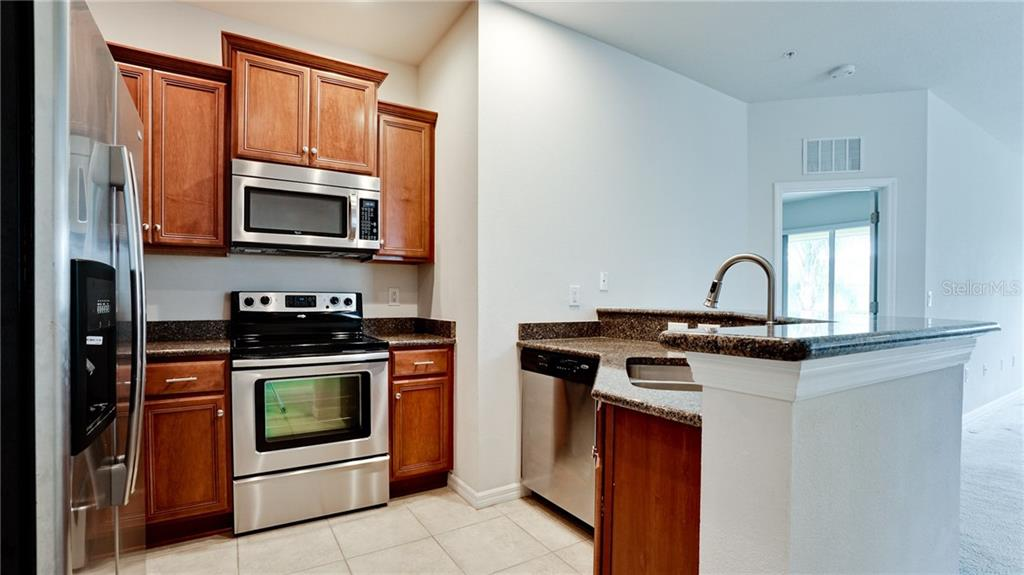 Appliances are like new and work as designed. Stove has two burners with double burners. Compact but fully functional! - Condo for sale at 7815 Moonstone Dr #24-204, Sarasota, FL 34233 - MLS Number is A4446867