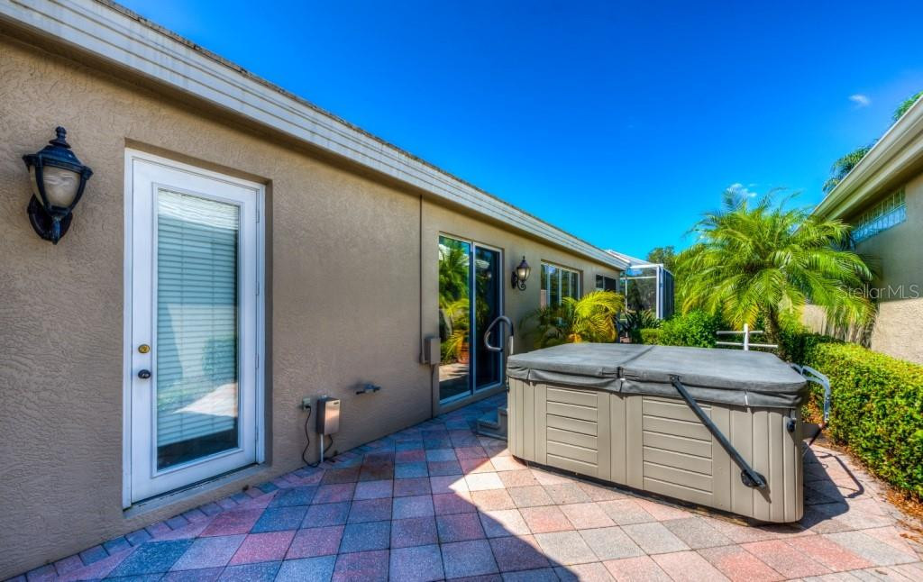 As private as can be! Enjoy the hot tub any time of day or evening to sooth your tired muscles. Separate electric heater. - Single Family Home for sale at 8727 53rd Ter E, Bradenton, FL 34211 - MLS Number is A4447005