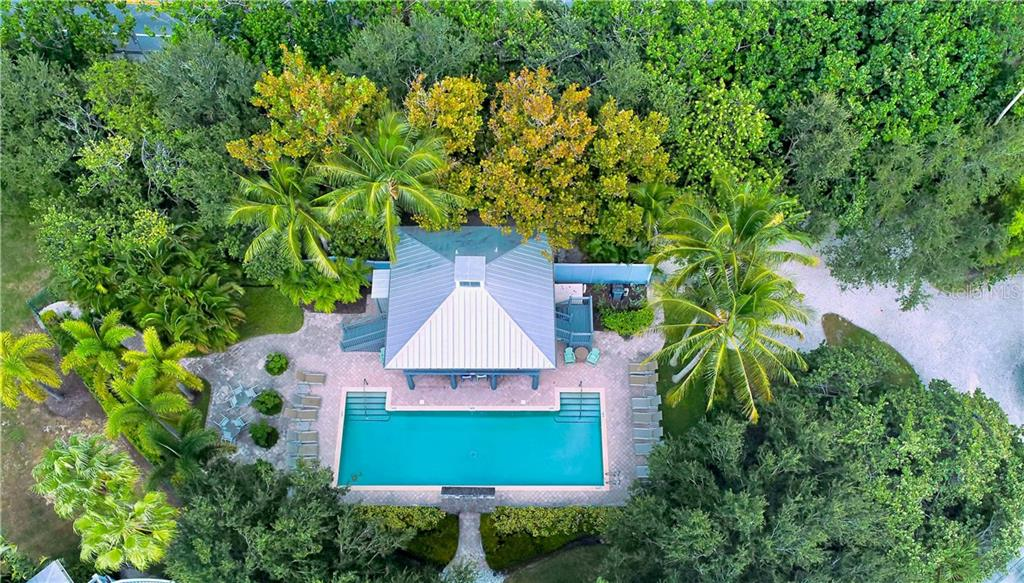 Backyard - Single Family Home for sale at 7010 Firehouse Rd, Longboat Key, FL 34228 - MLS Number is A4449332