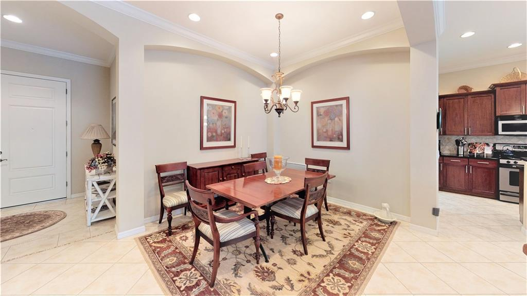 View of dining room, on the left the foyer, and on the right the kitchen - Single Family Home for sale at 7288 Lismore Ct, Lakewood Ranch, FL 34202 - MLS Number is A4449934