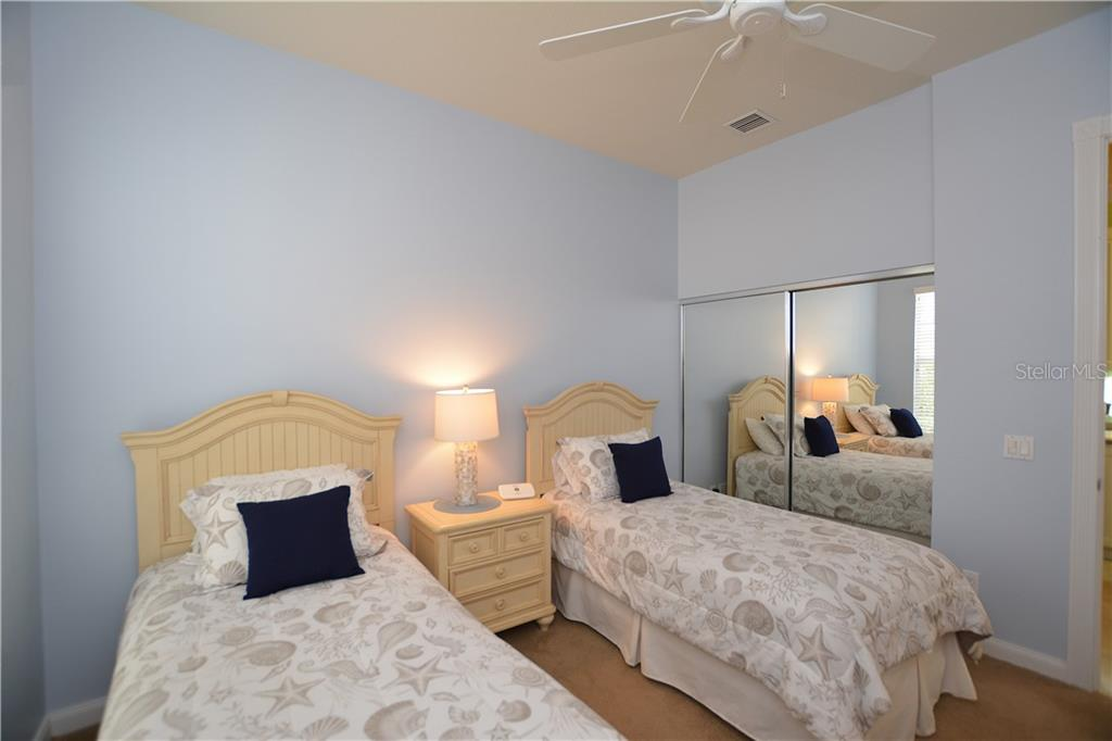 Bedroom 2 - Single Family Home for sale at 5799 Benevento Dr, Sarasota, FL 34238 - MLS Number is A4450677