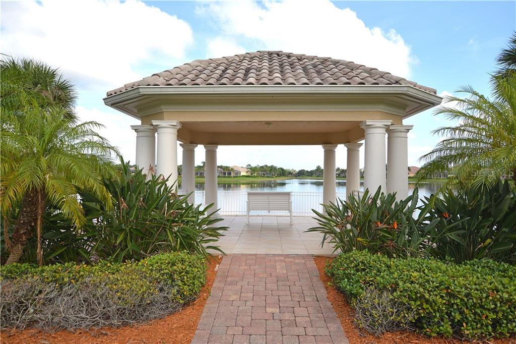 Stroll through the neighborhood and enjoy the bridges and gazebos along the way. - Single Family Home for sale at 5799 Benevento Dr, Sarasota, FL 34238 - MLS Number is A4450677