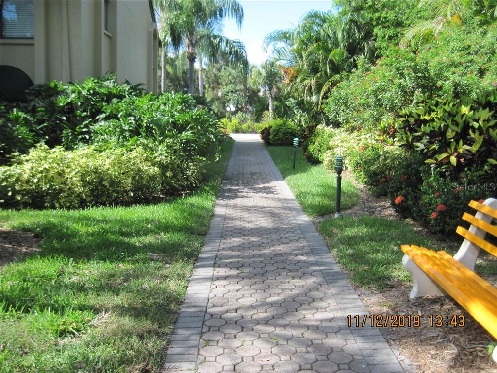 walk-way to Ashton Way - Condo for sale at 5525 Ashton Lake Dr #5525, Sarasota, FL 34231 - MLS Number is A4451290