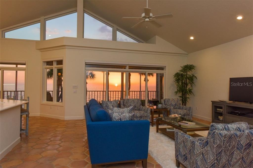 Sunset views light up the residence with soaring ceilings. - Single Family Home for sale at 1027 N Casey Key Rd, Osprey, FL 34229 - MLS Number is A4451976