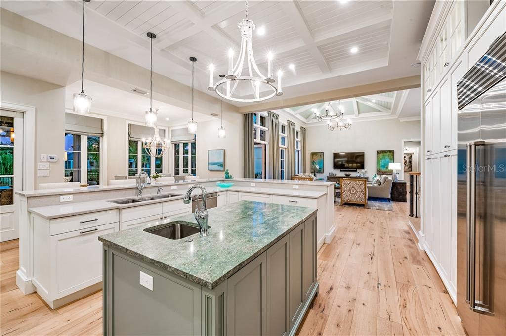 Sweeping Double Island in Kitchen Features Sophisticated Granite Center Island with Quartz Counters on Perimeter. - Single Family Home for sale at 16119 Baycross Dr, Lakewood Ranch, FL 34202 - MLS Number is A4452632