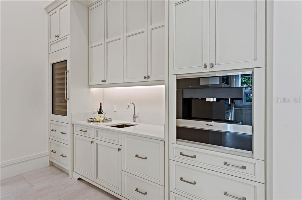 Butler's pantry offers a Miele coffee station with warming drawer, secondary dishwasher,  drawer style refrigeration, service sink, and Sub-Zero wine storage. - Single Family Home for sale at 552 Eagle Watch Ln, Osprey, FL 34229 - MLS Number is A4454431