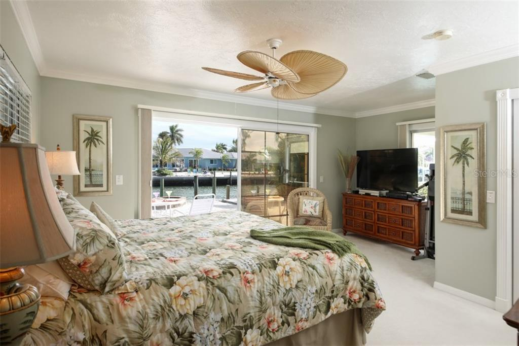 Single Family Home for sale at 622 Hampshire Lane, Holmes Beach, FL 34217 - MLS Number is A4454673