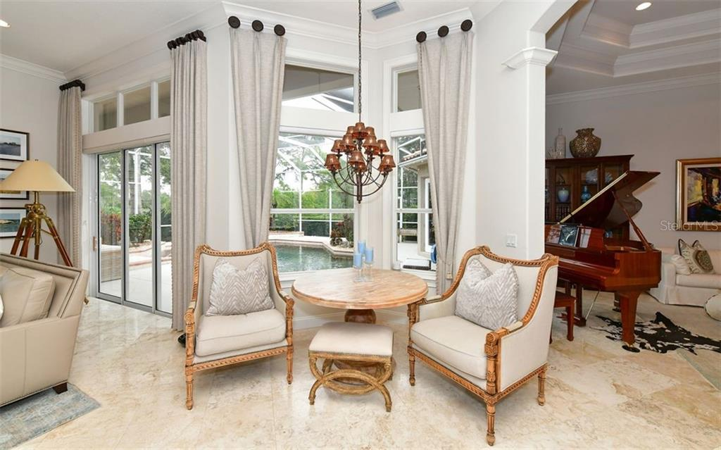 Sitting area - Single Family Home for sale at 574 N Macewen Dr, Osprey, FL 34229 - MLS Number is A4455085