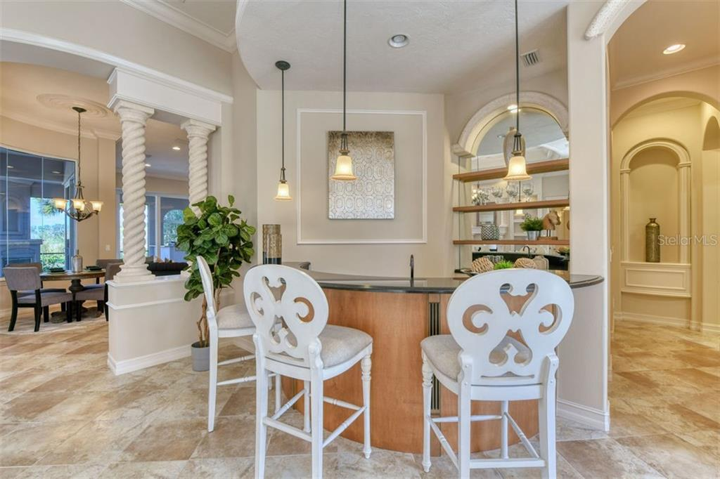 A friendly wet bar - Single Family Home for sale at 3719 Founders Club Dr, Sarasota, FL 34240 - MLS Number is A4455099