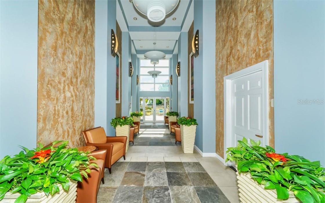 Hallway leading to the fitness center, common rooms, theater room and pool deck - Condo for sale at 100 Central Ave #A304, Sarasota, FL 34236 - MLS Number is A4458873