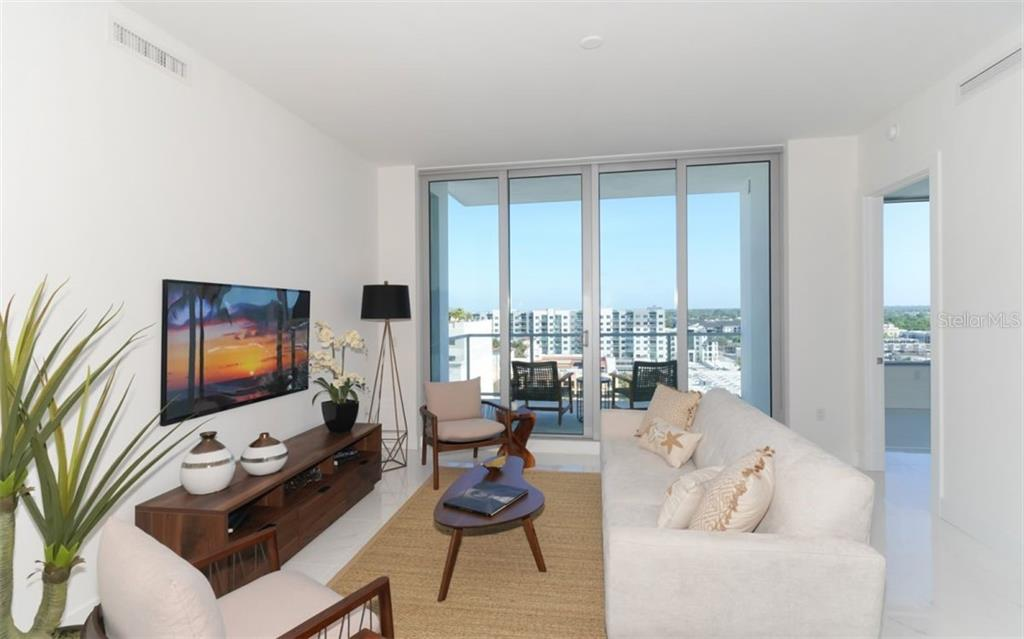 Living room & balcony access. - Condo for sale at 111 S Pineapple Ave #1117 L-1, Sarasota, FL 34236 - MLS Number is A4461778
