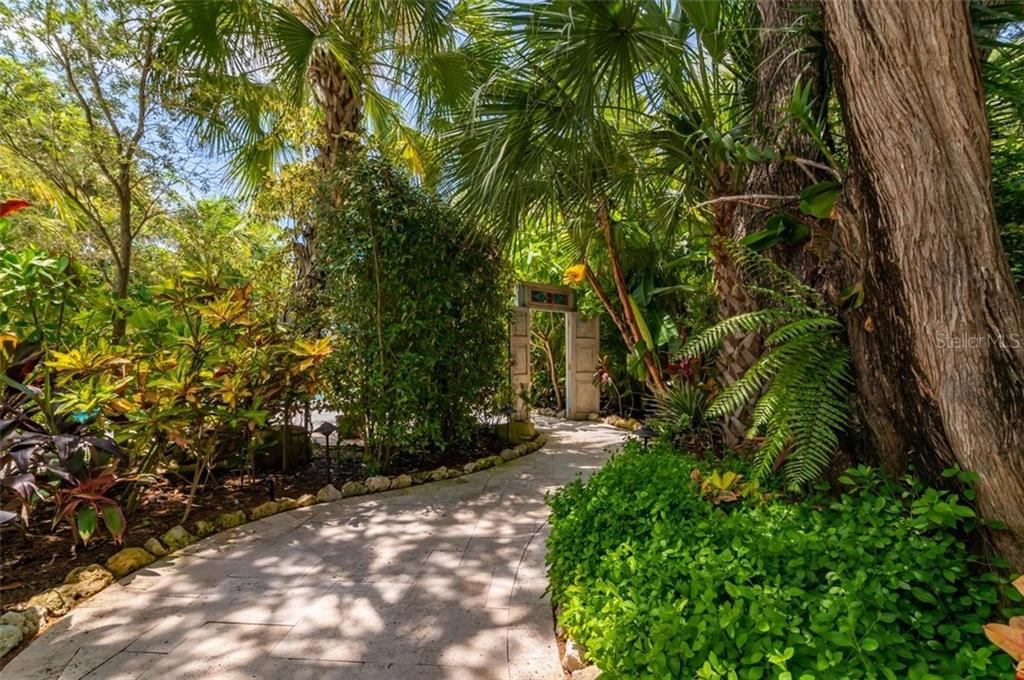 Travertine walkway to Residence - Single Family Home for sale at 7340 Point Of Rocks Rd, Sarasota, FL 34242 - MLS Number is A4461841