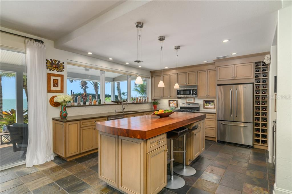 Kitchen w/ Access & View toward Gulf - Single Family Home for sale at 7340 Point Of Rocks Rd, Sarasota, FL 34242 - MLS Number is A4461841