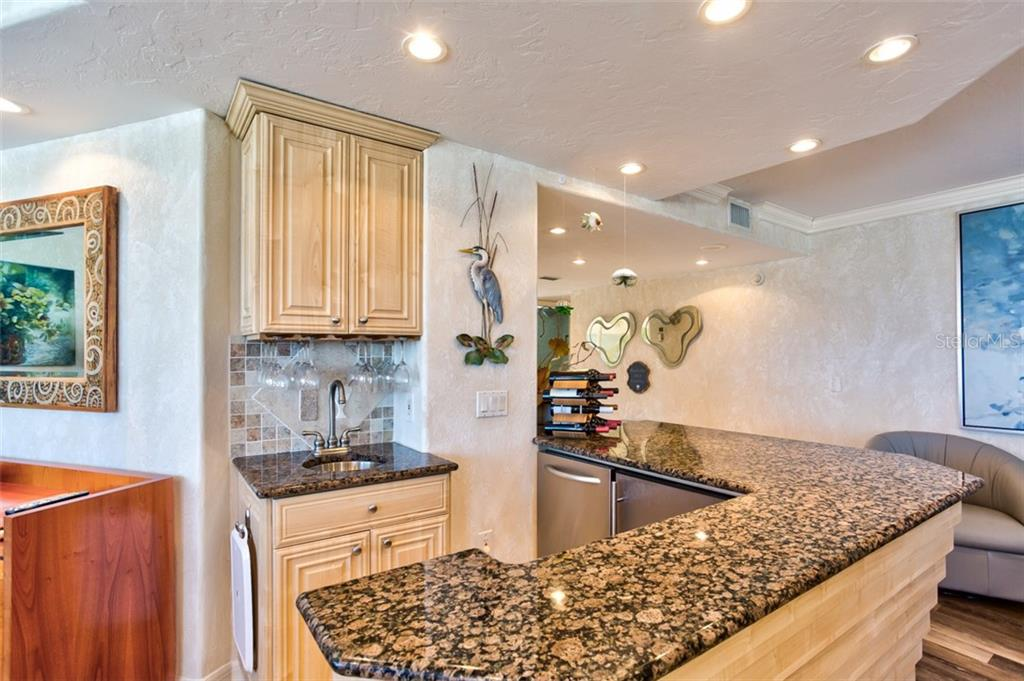 Wet bar that is part of the kitchen/dining area and perfectly accessible from the main living area will make your entertaining fun! - Condo for sale at 5880 Midnight Pass Rd #911, Sarasota, FL 34242 - MLS Number is A4462559