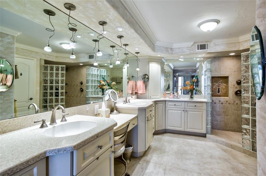 Counter-height dual sinks, vanity section and spacious walk-in shower make this the ultimate master retreat. - Condo for sale at 5880 Midnight Pass Rd #911, Sarasota, FL 34242 - MLS Number is A4462559