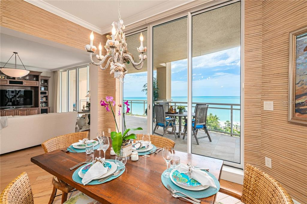 Living room/ dining room/ Great room with back to 75 x11 wrap around terrace - Condo for sale at 1300 Benjamin Franklin Dr #805, Sarasota, FL 34236 - MLS Number is A4462621