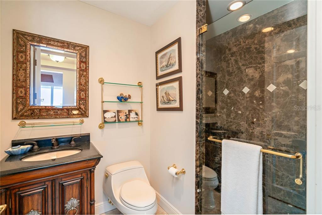 3rd full bathroom off hallway next to 3rd rm flex space - Condo for sale at 1300 Benjamin Franklin Dr #805, Sarasota, FL 34236 - MLS Number is A4462621