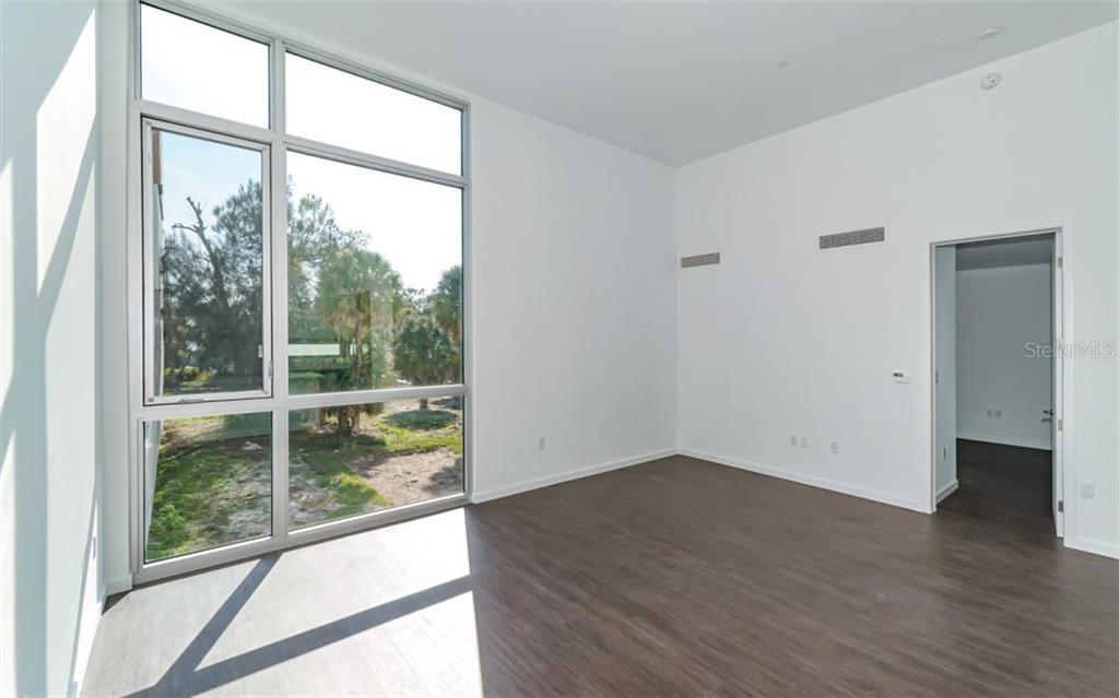Tasteful contemporary living and dining space. - Condo for sale at 1350 5th Street #104, Sarasota, FL 34236 - MLS Number is A4463799