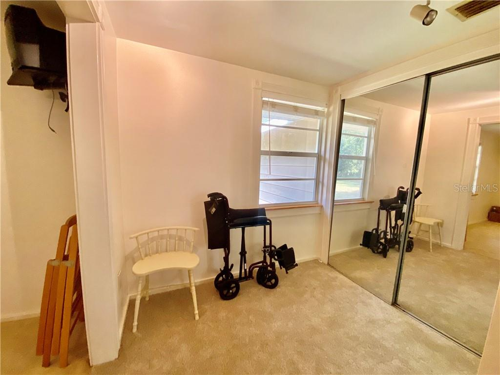 Changing room in the second bedroom with two closets. - Single Family Home for sale at 4300 Eastern Pkwy, Sarasota, FL 34233 - MLS Number is A4464200