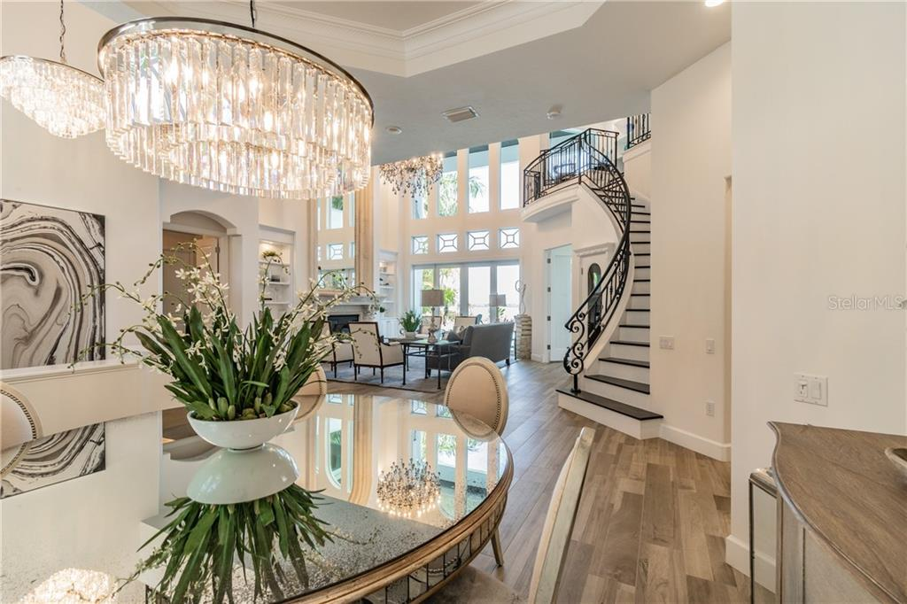Dining room/sample of stunning chandelier collection - Single Family Home for sale at 1418 John Ringling Pkwy, Sarasota, FL 34236 - MLS Number is A4467093