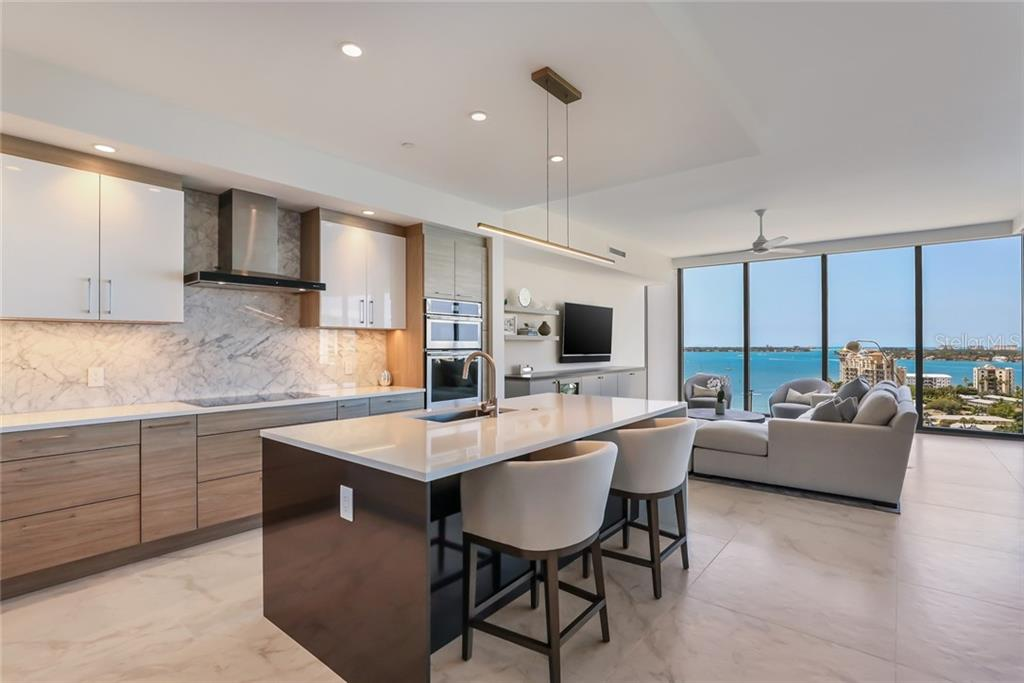 The marble backsplash adds even more sophistication to the open kitchen. - Condo for sale at 1155 N Gulfstream Ave #1404, Sarasota, FL 34236 - MLS Number is A4467921