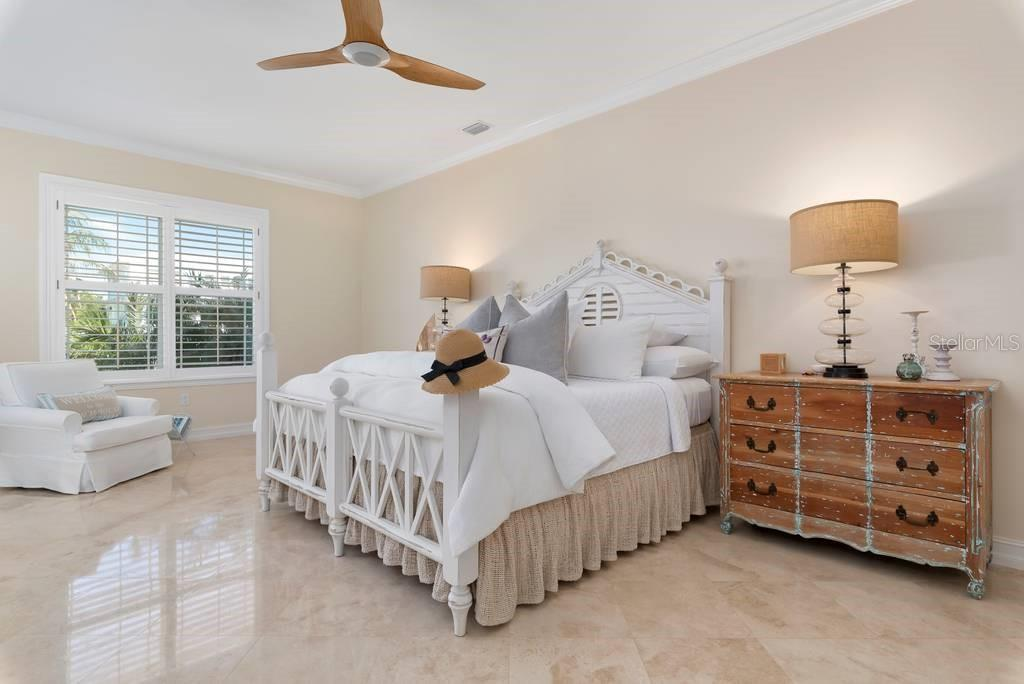 Ground floor master bedroom, walk in closet, bath and private patio - Single Family Home for sale at 605 N Point Dr, Holmes Beach, FL 34217 - MLS Number is A4469001
