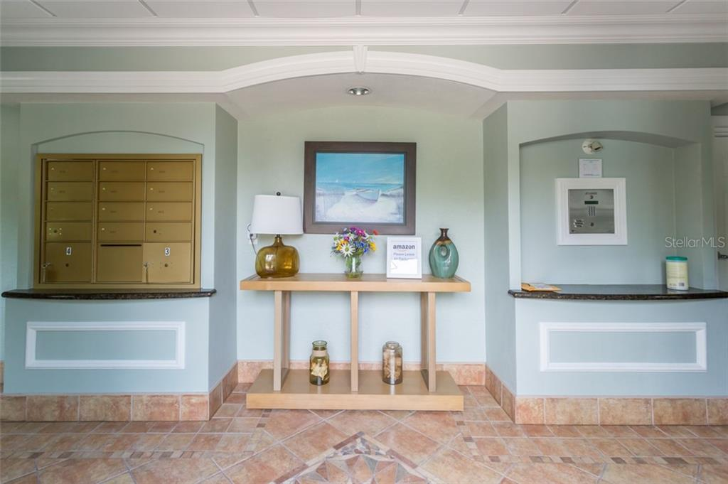 Lobby with mail boxes - Condo for sale at 1308 Old Stickney Point Rd #W24, Sarasota, FL 34242 - MLS Number is A4471155