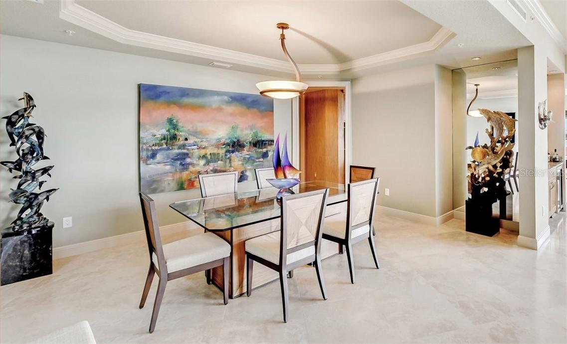 Wet bar adorned w/ wine fridge - Condo for sale at 1300 Benjamin Franklin Dr #708, Sarasota, FL 34236 - MLS Number is A4471978