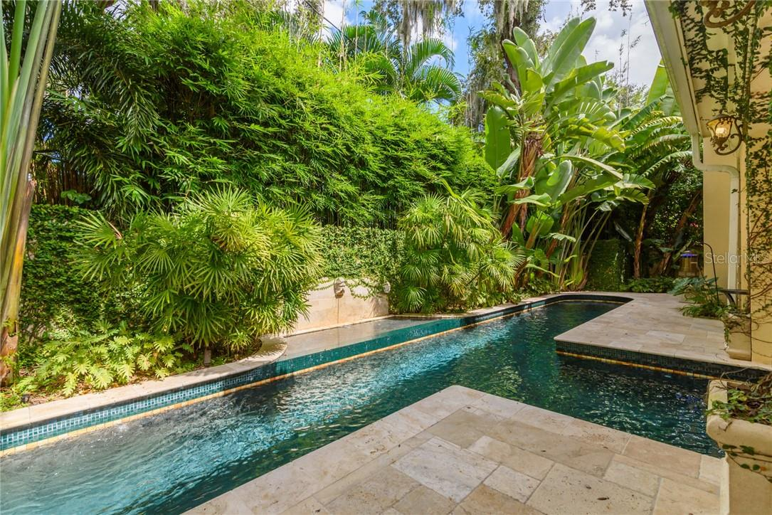 Imagine yourself in a tropical rainforest, rise early while it is still fresh and cool, and take your morning swim in the welcoming heated 45 foot lap pool. - Single Family Home for sale at 1807 Oleander St, Sarasota, FL 34239 - MLS Number is A4475067