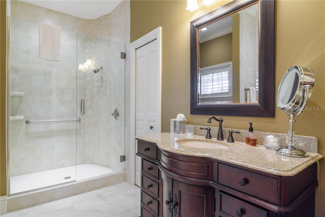 Upstairs guest bathroom features luxurious shower and marble flooring and walls. - Single Family Home for sale at 1807 Oleander St, Sarasota, FL 34239 - MLS Number is A4475067