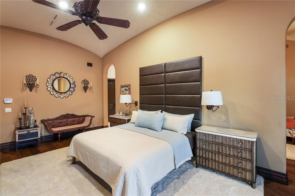 Master bedroom. Door to the right leads to a sitting room with a make up area. The door to the left leads to the closets and dressing area. - Single Family Home for sale at 4925 Topsail Dr, Nokomis, FL 34275 - MLS Number is A4475116