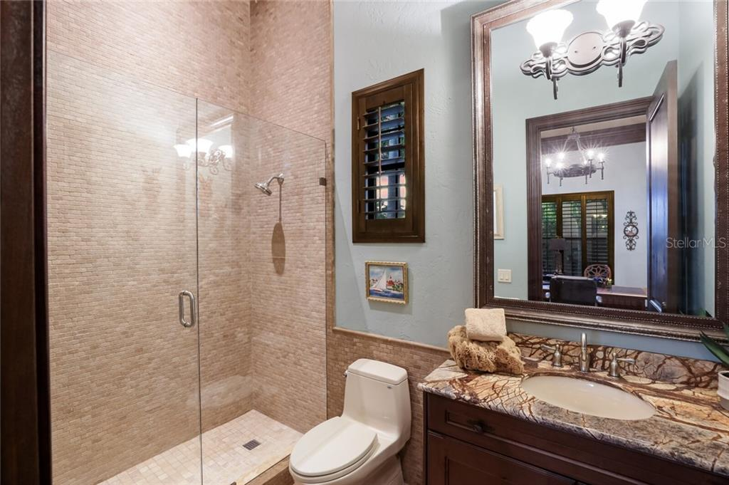 Office ensuite bathroom. - Single Family Home for sale at 4925 Topsail Dr, Nokomis, FL 34275 - MLS Number is A4475116