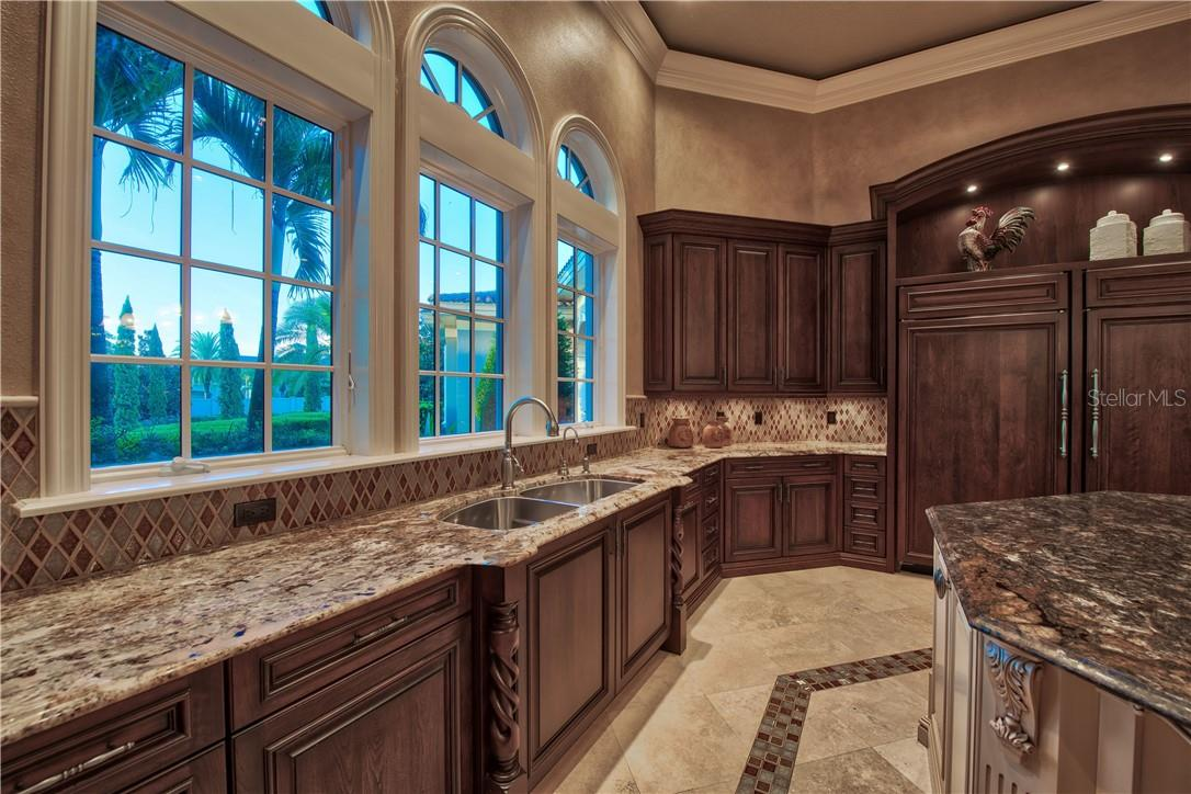 Tile Backsplash, Solid Wood Cabinetry, Stone Counters and Cleverly Hidden Appliances - Single Family Home for sale at 8499 Lindrick Ln, Bradenton, FL 34202 - MLS Number is A4475594
