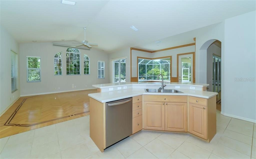 Kitchen to family room - Single Family Home for sale at 462 E Macewen Dr, Osprey, FL 34229 - MLS Number is A4476181