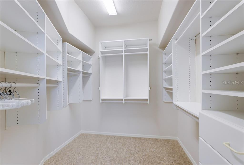The master closet features built-ins with ample storage and excellent lighting. - Single Family Home for sale at 9618 53rd Dr E, Bradenton, FL 34211 - MLS Number is A4477826