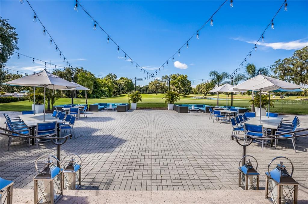 The bistro patio is a fan-favorite for Friday night happy hour and post-round cocktail hours. - Single Family Home for sale at 9618 53rd Dr E, Bradenton, FL 34211 - MLS Number is A4477826