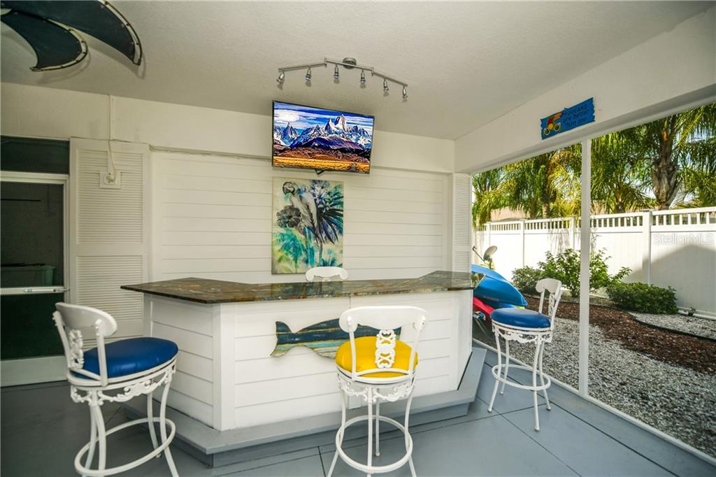 Screened in tiki bar. - Single Family Home for sale at 7303 Westmoreland Dr, Sarasota, FL 34243 - MLS Number is A4478376