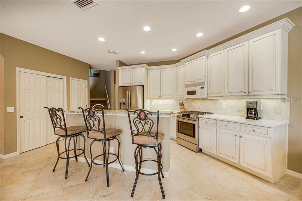 Stunning kitchen in trending creams. - Single Family Home for sale at 684 Crane Prairie Way, Osprey, FL 34229 - MLS Number is A4478575
